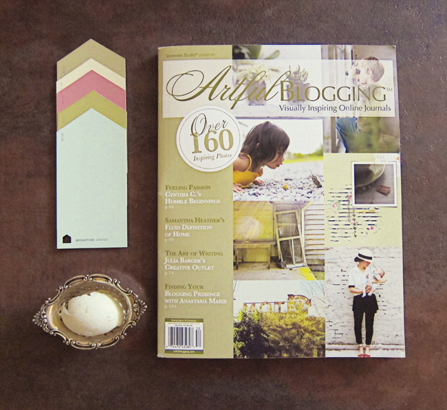 Magazine, paint chips, antique silver nut cup, duck egg shell.